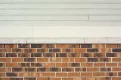 brick and vinyl wall, beige brown and creme Royalty Free Stock Image