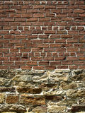 Brick vs Rock. An exterior wall with half brick and half stone stock photo