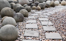 Brick walk way and ball rock Royalty Free Stock Photography