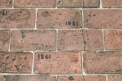 Brick Walkway Etched With Year 1861 and 1981. A brick walkway etched with year 1861 and 1981 royalty free stock photo