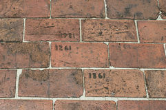 Brick Walkway Etched With Year 1861 and 1981. A brick walkway etched with year 1861 and 1981 royalty free stock photography