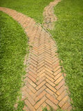 Brick walkway. In the park on green grass Stock Images