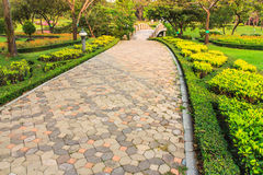 Brick walkway in the park. With green trees Stock Photography