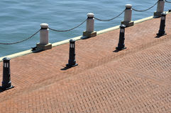 Brick walkway by water Royalty Free Stock Photography