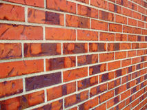 Brick Wall 04. A red brick wall shot with a perspective point of view Royalty Free Stock Photos