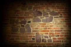 Brick wall. Old brick wall with stones Stock Image
