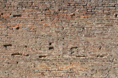 Brick wall. Damaged wall from old bricks Royalty Free Stock Photo