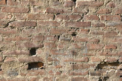 Brick wall. Damaged wall from old bricks Stock Images