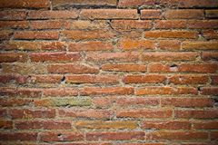 Brick Wall. Old red brick wall with dark corners for design background Royalty Free Stock Photo