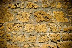 Brick wall. Old yellow brick wall with dark corners for design background Stock Photos