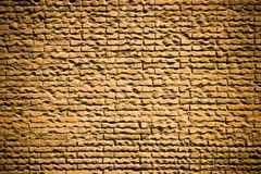 Brick wall. Old yellow brick wall with dark corners for design background Royalty Free Stock Photos