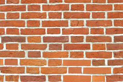 Brick wall. Red brick wall built of different stones. Can be used as background Royalty Free Stock Image