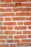 Brick wall. A grunge wall texture. The facade view of brown brick wall. Could be used as design background Stock Photos