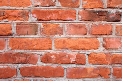 Brick wall. A grunge wall texture. The facade view of brown brick wall. Could be used as design background Royalty Free Stock Photos