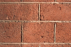 Brick wall. A grunge wall texture. The facade view of brown brick wall. Could be used as design background Royalty Free Stock Photography