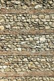 Brick wall. The brick and rocks in a wall form an interesting pattern stock photography