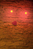 Brick wall. Decorated for valentine's day Illuminated lover's wall with red heart stock photography
