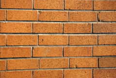 Brick Wall. Background pattern of a light brown brick wall royalty free stock photo