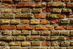 Brick wall. Brickwall of handmade stones on old church Royalty Free Stock Photo