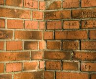 Brick wall. Old brick wall with carved initials Stock Image