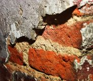 Brick Wall. Exposed bricks in a dilapidated wall Stock Image
