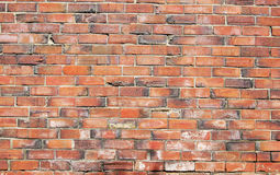 Brick wall. An old worn brick wall stock image