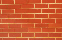 Brick wall. A new brick wall with red bricks stock photos