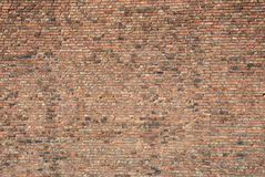 Brick Wall. Very large expanse of old brick wall with a variation of a huge amount of bricks of different colours for background Landscape view Stock Photo