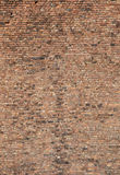 Brick Wall. Very large expanse of old brick wall with a variation of a huge amount of bricks of different colours for background portrait view Royalty Free Stock Image