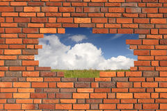 Brick wall. With gap revealing landscape Stock Photo
