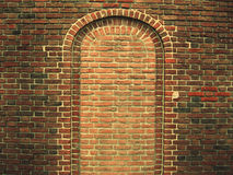Brick wall. Hiding arc in the wall Royalty Free Stock Photo