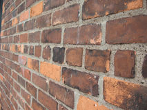 Brick wall. A closeup of a brick wall, with different colours and sizes of bricks stock images