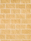 Brick wall. Yellow modern wall made with cement blocks Stock Photography