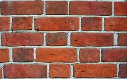 Brick wall. Red old brick textured wall. Cracked bricks Stock Images