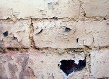 Brick wall. Close up of a grungy peeling brick wall royalty free stock photos