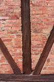 Brick wall. With eroded bricks and wooden beams Royalty Free Stock Images