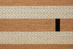 Brick wall. With black window Royalty Free Stock Photography