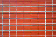 Brick wall. A typical red brick wall. Useful as background stock photos
