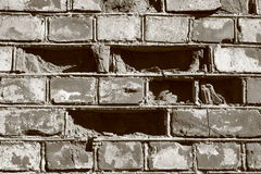 Brick wall. Old brick wall, with broken bricks Stock Images