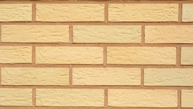 Brick wall. Yellow brick wall Royalty Free Stock Image
