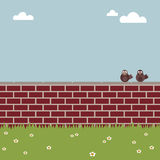 Brick wall. Two birds on a wall with copy space Royalty Free Stock Images