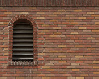 Brick wall with acrhed vent Royalty Free Stock Photos
