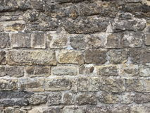 Brick wall of an ancient castle. Grey color photo of a old brick close up on the wall Royalty Free Stock Photos