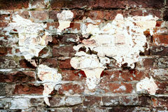 Brick Wall And A Picture Map Of The World Royalty Free Stock Images