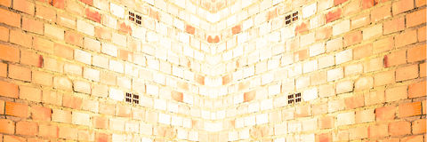 Brick wall at an angle. Treated Composition effects and panoramic background or texture symmetrical brick wall Royalty Free Stock Photos