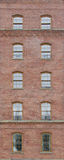 Brick wall with arch windows Stock Photos