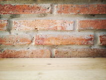 Brick  wall architect and interior design. Brick wall  and wooden table Royalty Free Stock Images