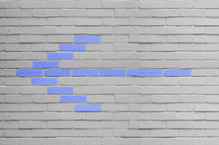 Brick wall with arrow Royalty Free Stock Image