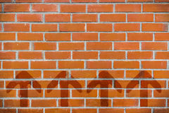 Brick wall with 4 arrows point up Royalty Free Stock Photography