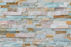 Brick wall as background. Renovated house wall covered with insulation and with a beautiful brick stone Royalty Free Stock Images